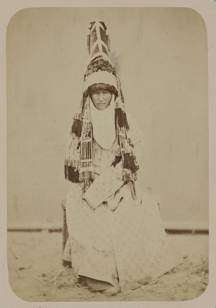 A woman from Kyrgyzstan around 1870 wearing the Saukele ceremonial hat. Image: Library of Congress.