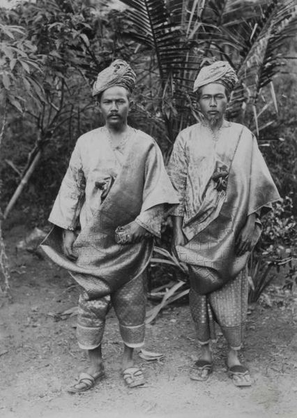 "The Minangkabau people of Sumatra still practice pre-Islamic ethnic traditions – what's called ""adat"" in the Muslim world – in addition to their Islamic practices. These men are wearing adat clothing circa 1900. Image: C.B. Nieuwenhuis, Tropenmuseum."