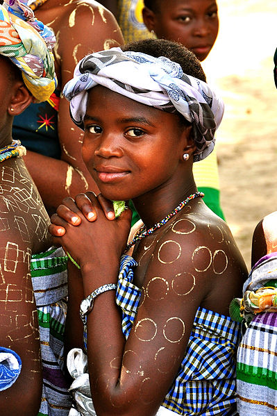 A Ghanaian girl in ceremonial dress. Image: Kasia McCormick, USAID.