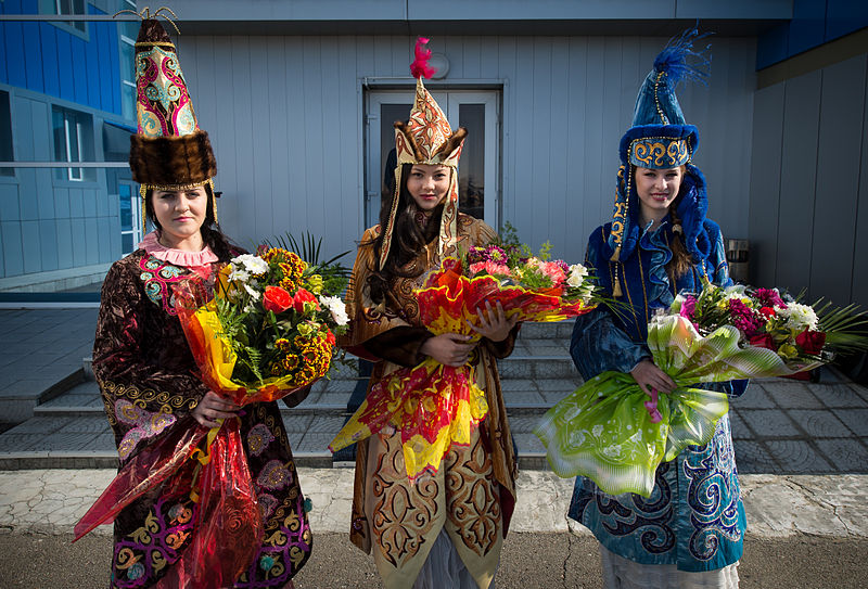 Women in ceremonial Kazakh dress. Image: Bill Ingalls, NASA.