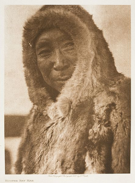 A man from Hooper Bay, Alaska in 1928 wears an Inuit parka. Edward S. Curtis, Los Angeles County Museum of Art.